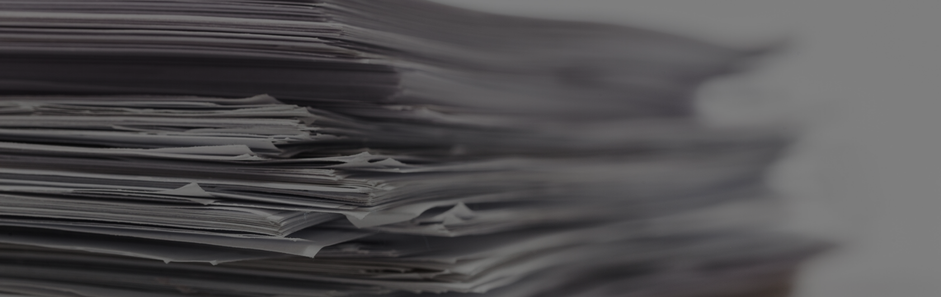 Close up photo of a stack of papers